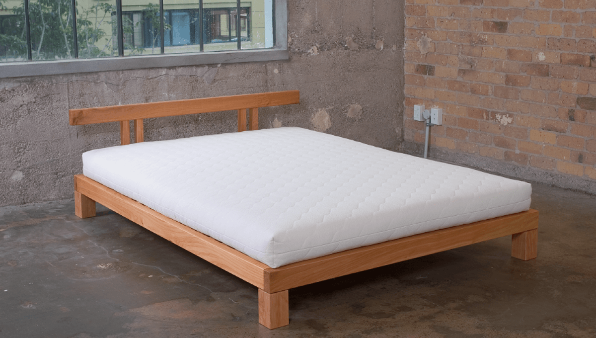 New Zealand made solid wood bed frame with organic latex mattress